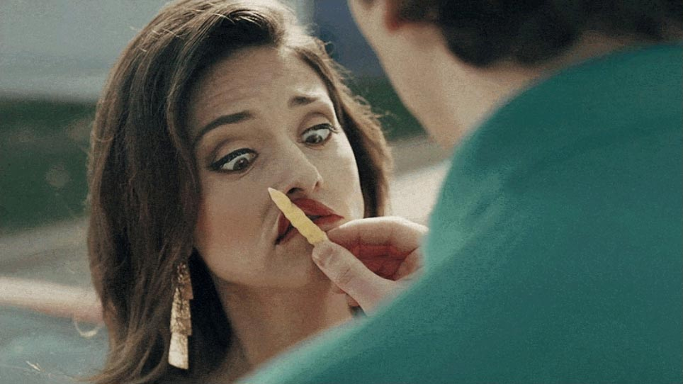 Women embraced by a Runza fry being put on her lips - Still Image