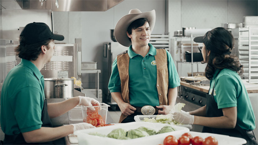 Employee dressed in western outfit